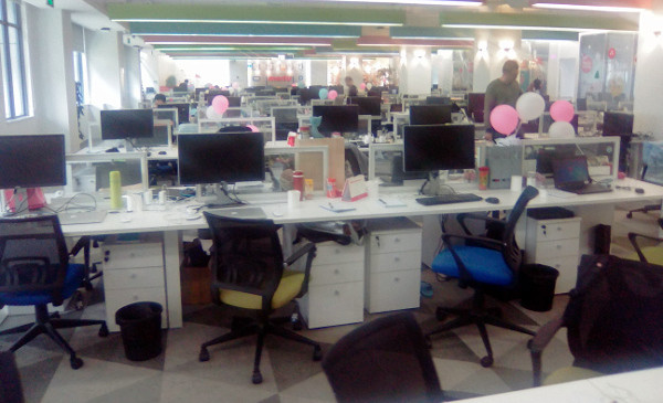 The office in Meitu company. Saturday, 12 AM – hundreds of mostly empty desks because it is weekend and the crew is on a well-deserved rest; the company has top-quality organization and there is no need for late-night hours – that is also the new China